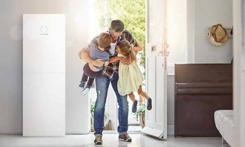 Shot of a father embracing his two children as he enters the house